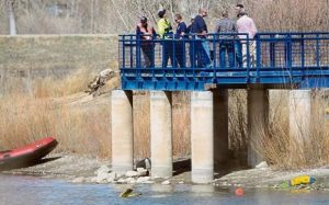 Police divers searching area of Golden Ponds in Longmont, Colorado. Courtesy of Daily Camera.